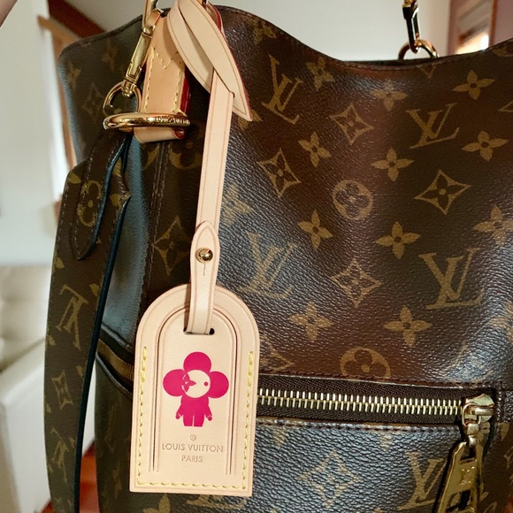 d83421d84fe66 Brand new Louis Vuitton luggage tag